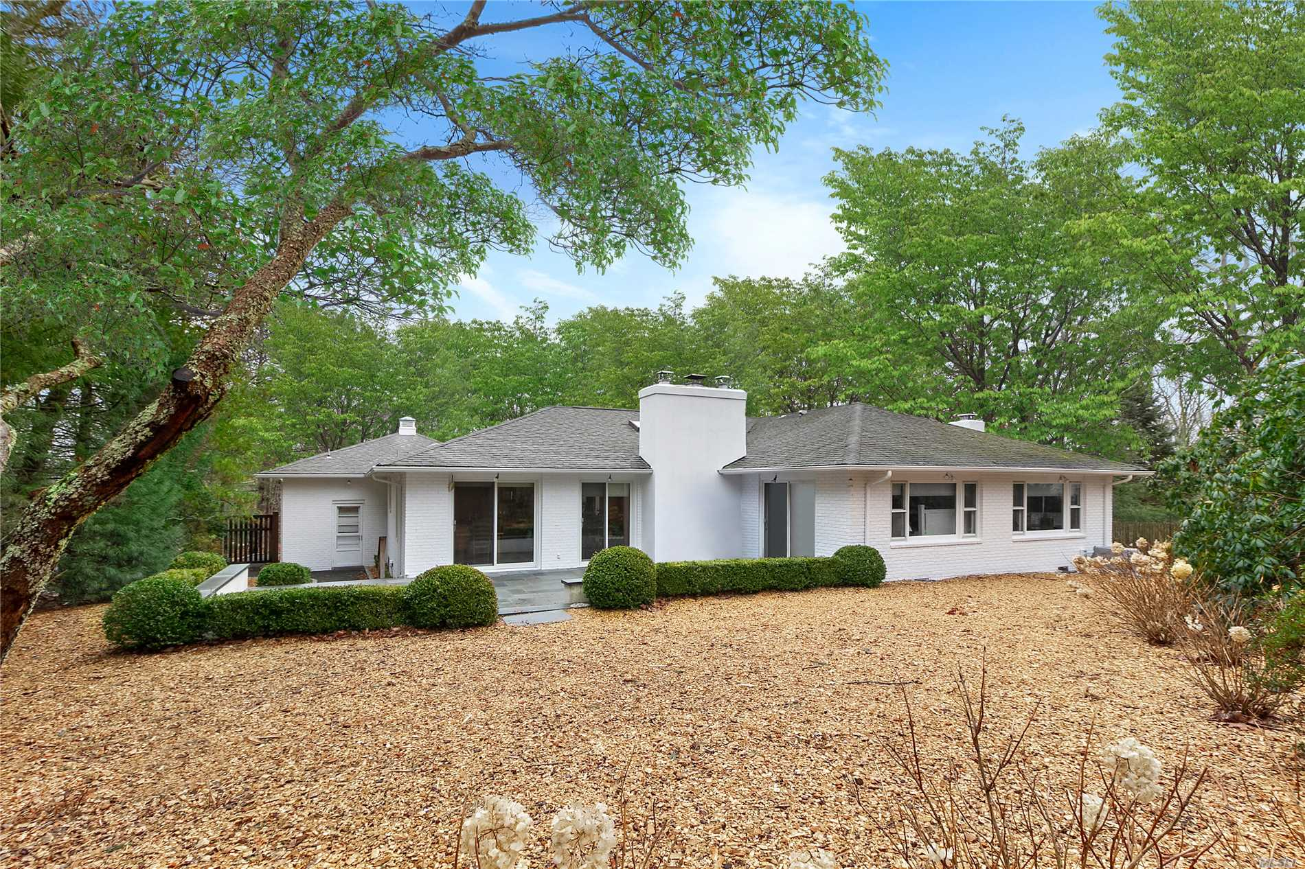 New to market, this charming 3 bedroom 3 bathroom home in private Hampton Waters community and close to East Hampton Village. This light and airy one level home has a two-car garage and a generously size backyard with room for pool.
