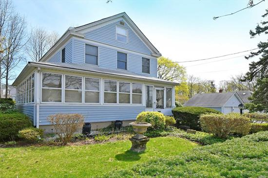 Lovely Manhasset Colonial. Features Include: A Spacious LR, Formal DR, Eat-In-kitchen, 3 Bedrooms, 1.5 Baths, Wrap Around Sunroom, Full Basement, Walk Up Attic , Beautiful Property 100X100 Conveniently Located Near Town And Transportation.