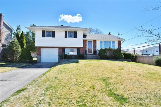 Immaculate Split. Home Features Large Living Room, Dining Area, Eat-in-Kitchen with s/s appliances and CAC. Bedrooms and Living Room/Dining room Offer Hardwood Flooring under carpet. Property boasts a Flat Backyard and patio area great for entertaining. Commack Blue Ribbon Schools. A Must See! See Virtual Tour.