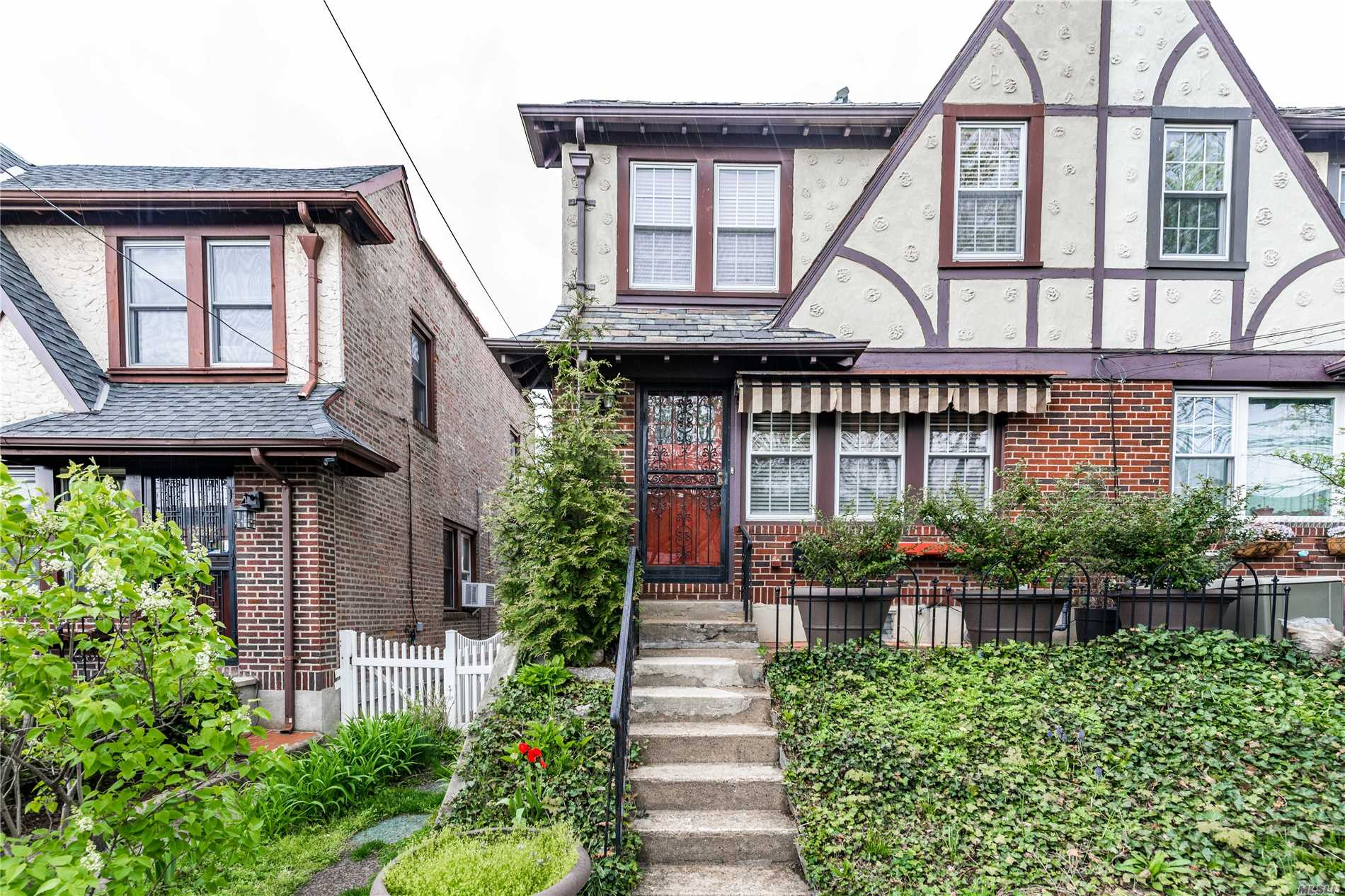 Semi-Detached Single Family Home For Sale In Forest Hills. Shows Beautifully With Designer Touches Throughout. Newly Finished Flooring, Open Concept On First Floor, Private Yard With 2 Car Detached Garage. Convenient To Subway And Shopping.
