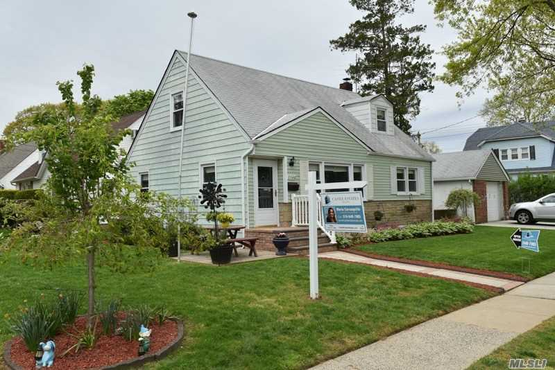 SPACIOUS AND BRIGHT CORNER CAPE FEATURES 3 BEDROOMS, FULL BATH, EAT IN KITCHEN, LARGE BEDROOM AND WALK IN CLOSET, PARTIAL FINISHED BASEMENT W/WASHER & DRYER, EXTRA FRIDGE, DET GARAGE, PRIVATE YARD!