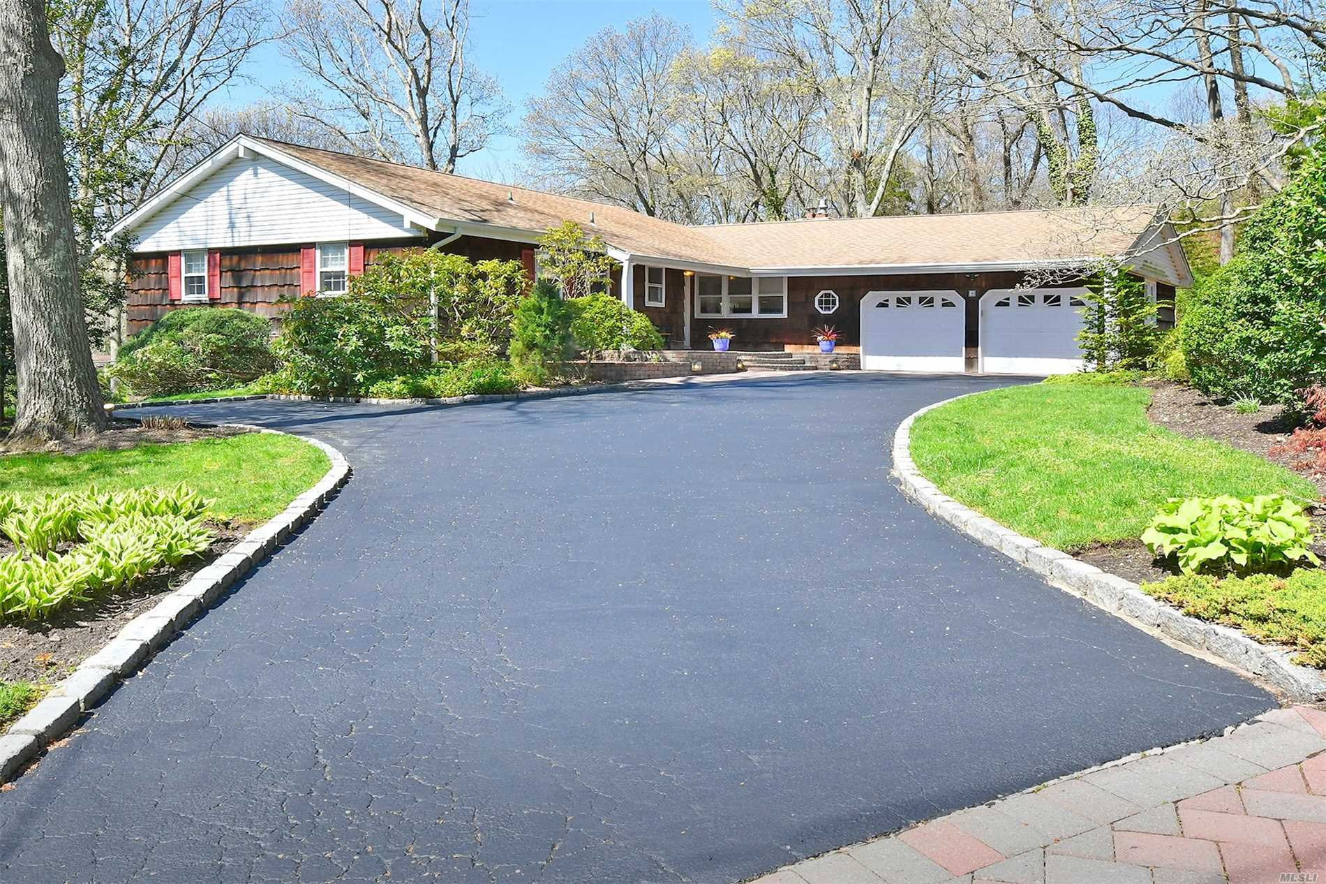 Lovely 3 Bdrm 3 full bath Pt of Woods ranch situated on stunning 1.12 acre property. Gorgeous heated, 20X40 IGP with multi level, composite decking. Cozy, sunlit family room w/gas, marble fireplace & rich wood floors. New paver stoop, updated roof, furnace, compressor & air handler. Walk out basement with double doors to country club yard. Half Hollow Hills SD.