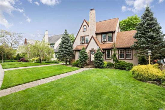 Tudor Style Home on Oversize Parklike Property. This Home Offers Loads Of Charm! Beautiful Living Room With Hard Wood Floors & Wood Burning Fireplace. Banquet Size Formal Dining Room, Sun Room/Den With Sliders To Yard. Queen size Bedrooms , possibility of 5 Bedrooms, 2 Car Garage And So Much More!