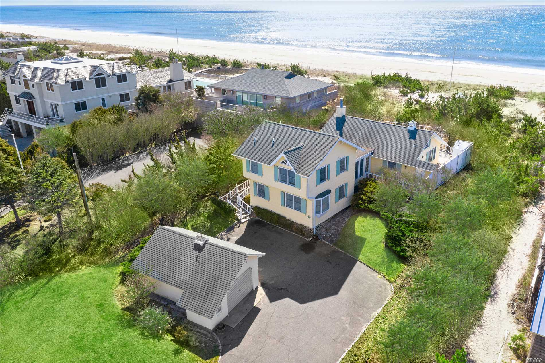Opportunity is Knocking! Rarely does a classic Quogue oceanfront home come on the market. Savor 100 feet of ocean front on a wide stretch of highly desirable pristine beach conveniently near the Post Ln bridge. The original home was built in 1935 and survived the Hurricane of '38 The cottage was expanded in the 1980's and a beautiful great room with beamed cathedral ceilings and fireplace was added. Enjoy as is, renovate or build your dream home. Room for pool. Low taxes.