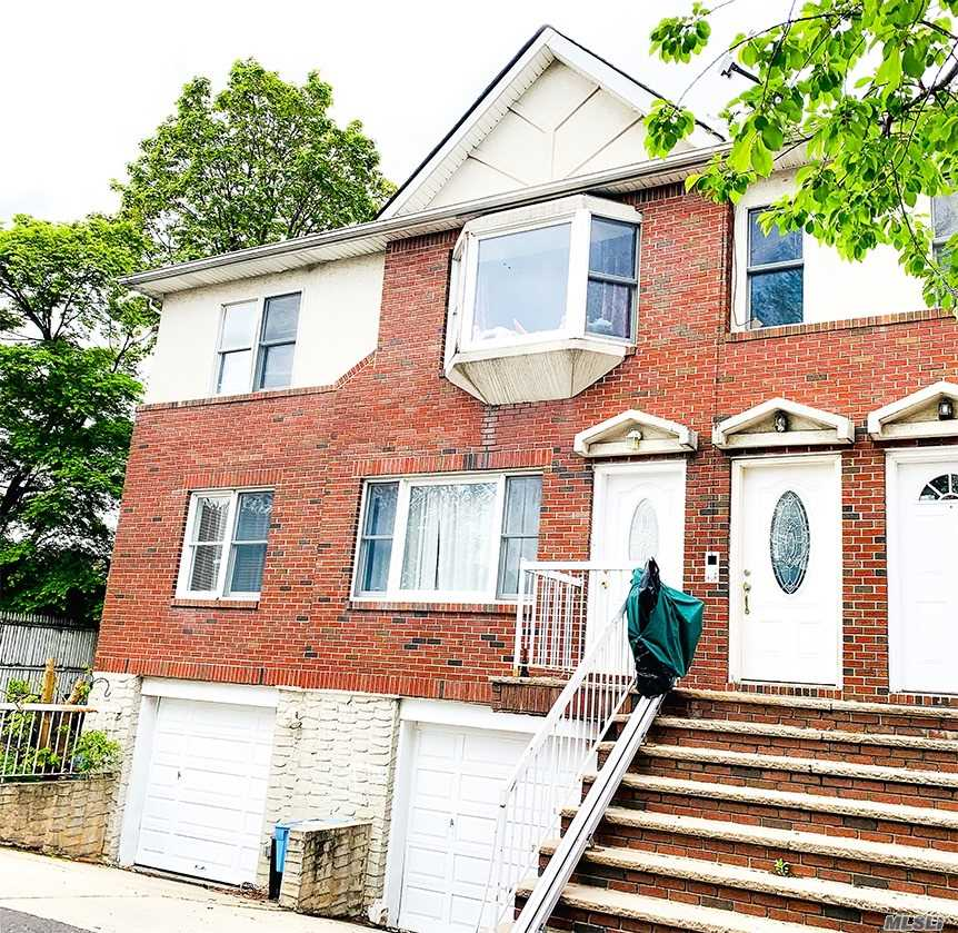 Huge two family with an excellent condition (1300 Sft per fl). New roof, new central air system. Custom made kitchen cabinet with granite counter top. Hardwood floor. Finished basement with high ceiling and separated entrances. Two garages with plenty of storage space. The huge patio is great for entertaining . South facing, great sunny light in each room. 5 minutes walk to supermarket, shopping center, and multiple bus stops. Close to a major highway, easy commute. Much more!