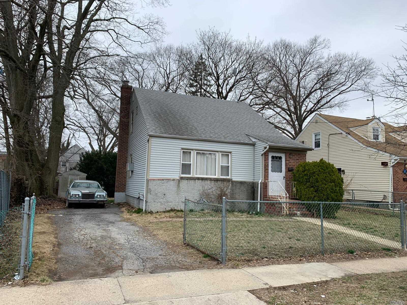 Detached Two Family Cape With Private Driveway and Full/Unfinished Basement Located In The Hempstead Section of Nassau County. The Property Features Three Bedrooms And Two Full Bathrooms.