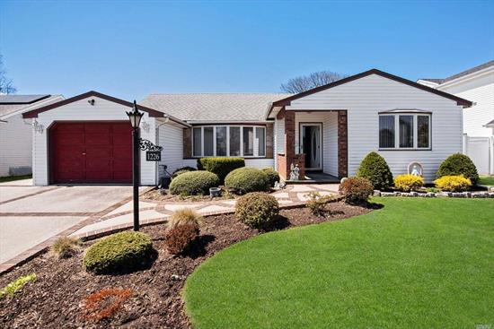 Beautiful 3 BR Ranch in desirable Wantagh Woods! Spacious EIK with Granite. MBR w/Fl BA, Den w/4 Skylights, cathedral ceilings, wood burning FPL, and Slider to back patio. Full basement w/Laundry, Utilities, Pantry & Cedar Closet. IGS in front & back, motorized awning, 1.5 car att garage, fully-fenced yard!