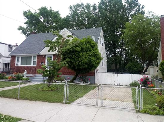 ALL BINDERS OFF !! Extraordinary Expanded Cape, Possible Mother, and Daughter with a Proper Permit, Siting on 60x100  Lot - Located in the Heart of Elmont- Close to the Mayor Highways and Transportation, Library, Parks, LIRR, Bus to Subway and MUCH MORE!!!