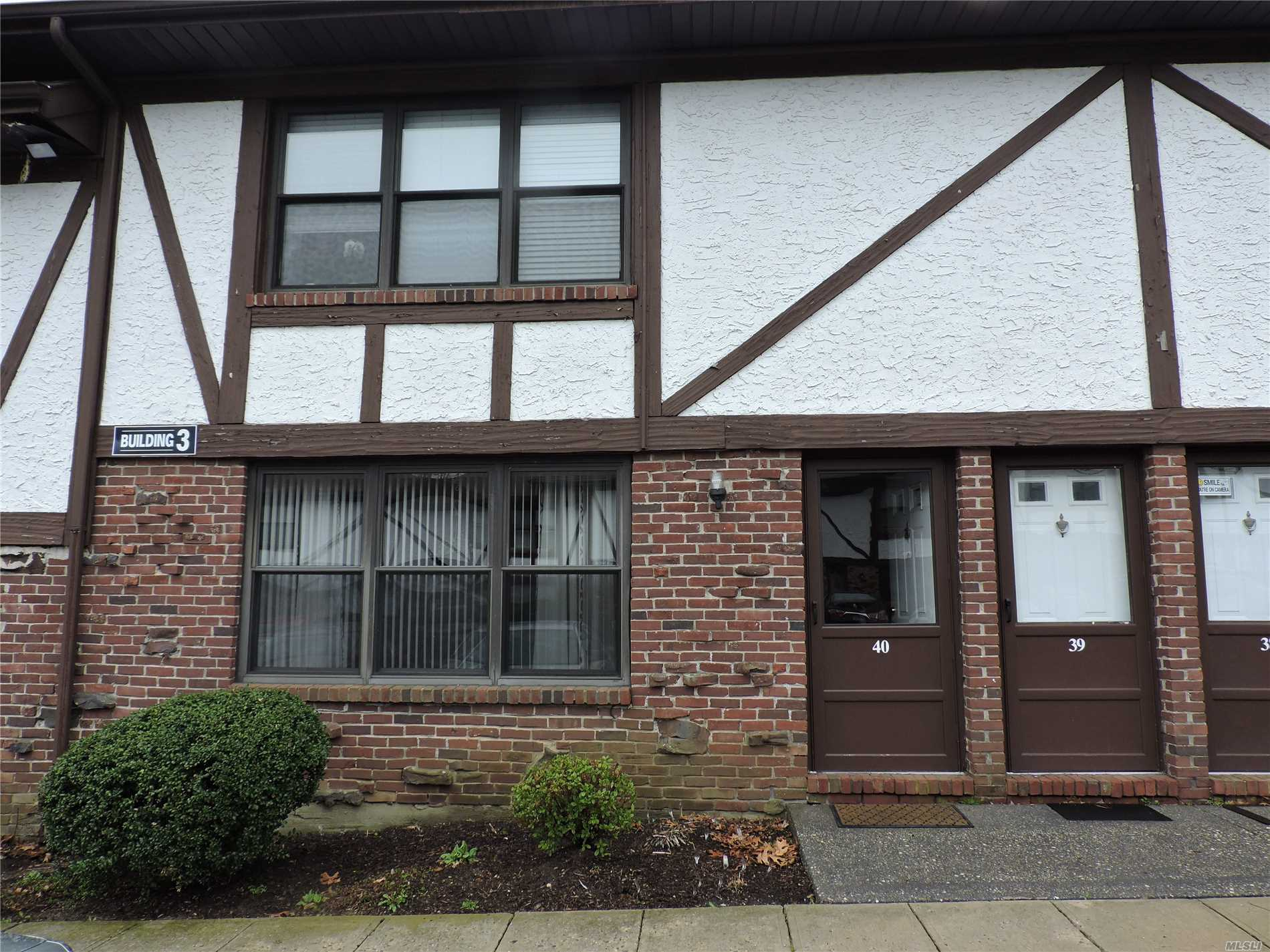 Picture Perfect 1st floor with patio for entertaining. New Appliances in newer kitchen with custom cabinetry. New wood laminate floors throughout, New heating & air system!, Common charges $700. includes taxes, heat, garbage & water!