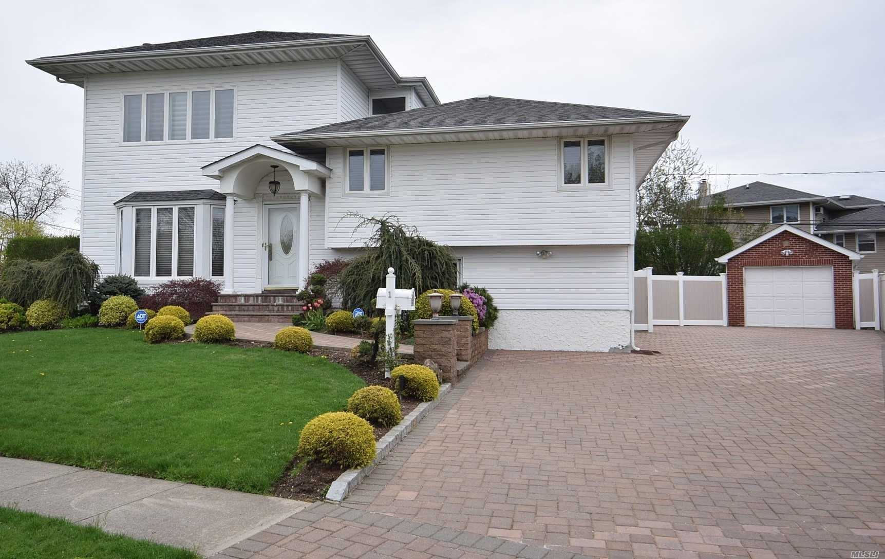 Move-in Ready, Beautifully Expanded and Renovated 2008, Huge Master Bedroom Suite with Full Marble Bath( Jacuzzi) and Walk in closet, Expanded Den, Gorgeous Hardwood Floors, Gas Heating, Large 2Tier Trex Deck, Brick Patio, PVC Fenced Parklike Property for Entertainment with Putting Green