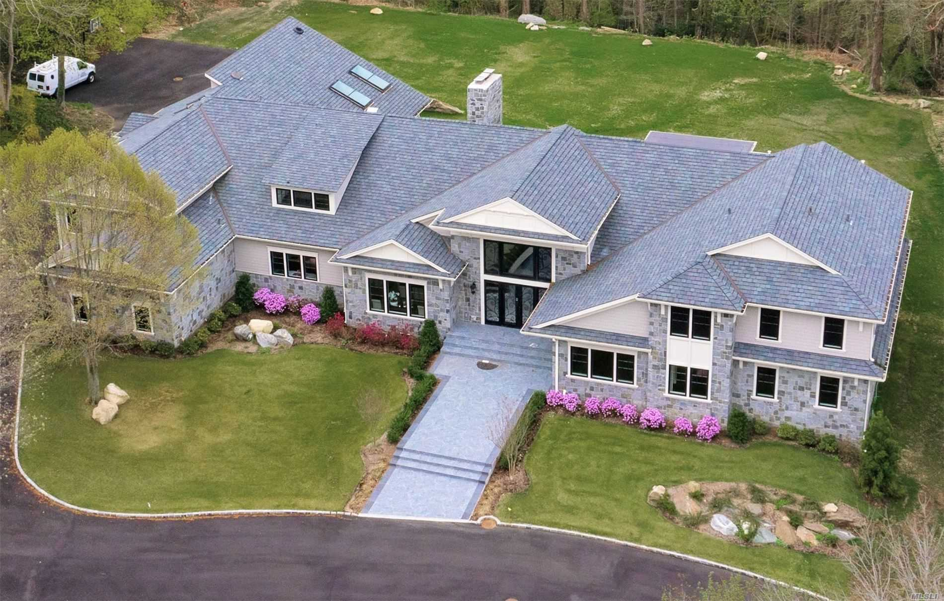 Grand 10, 000 sq.ft. of luxurious living space, incredible new construction with indoor pool. Situated in the waterfront community in Lattingtown Harbor featuring a beach house, mooring rights and daily sunsets. Smart house with three central iPad stations, many green features, smart everything-appliances, sonos, temperature controlled shower, wine cooler, home theatre, outdoor kitchen and fire-pit. Finest custom built-ins with high end finishes, entertainment center and bar in family room.