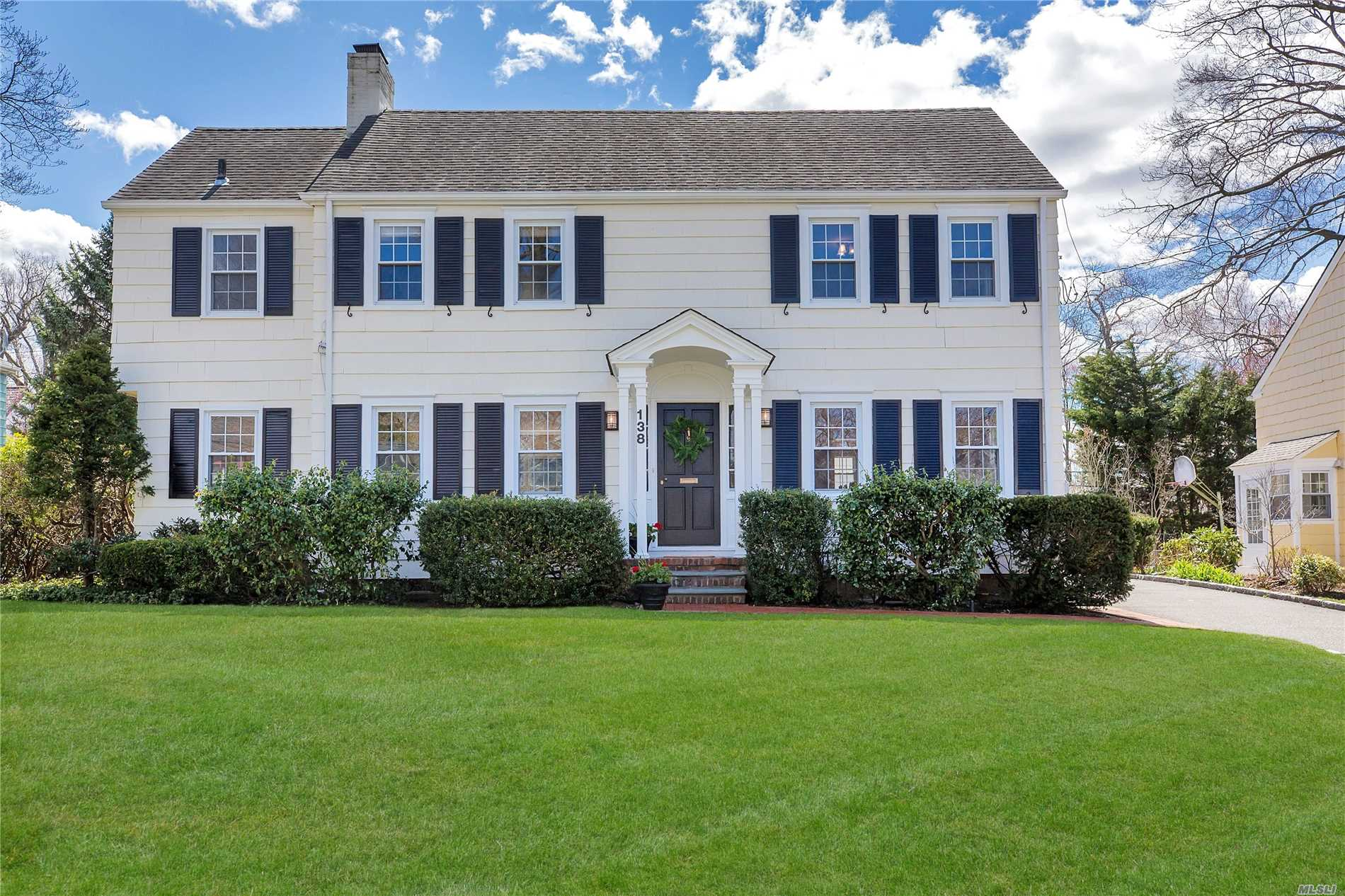 Classic Center Entry Colonial, Gourmet Kitchen, Elegant Living Room w/Fireplace, Formal Dining Room, Sunny Den With French Doors That Open To a Lovely Yard with patio, professionally landscaped property, Detached Garage, CAC, Wood Floors, Many Upgrades. Must See This Beautiful Home.