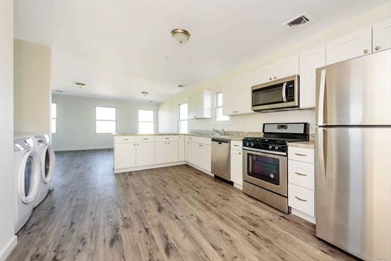 Rare Opportunity To Own Brand New Fema Compliant Legal 2 Family Home On Wide Block In The West End. Two Floors Each With 2 Bedrooms, 1 Full Bath, Kitchen, Living/Dining Area, Washer And Dryer. Private Driveway For 2-4 Cars.