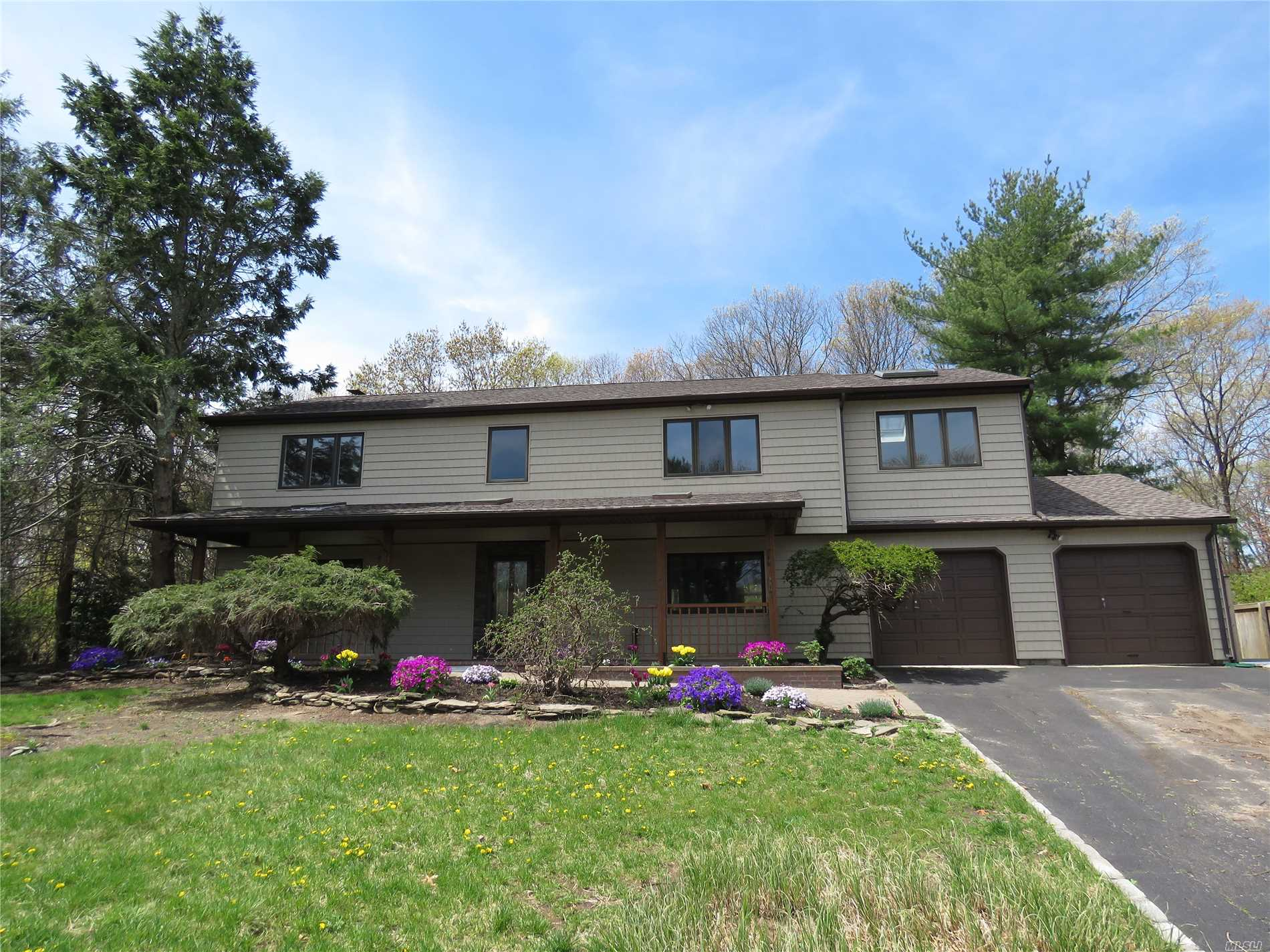 Spacious 4/5 Bedroom Expanded Colonial located in Desirable South Setauket Park. Three Village SD. Spacious Eat-n-Kitchen w/ Granite Island and Countertops, Custom Wood Cabinetry and Wood Flooring. Formal Dining Room. Den with Fireplace. Master Bedroom & Master Bath With A Sitting Room or 5th Bdrm w/ Balcony