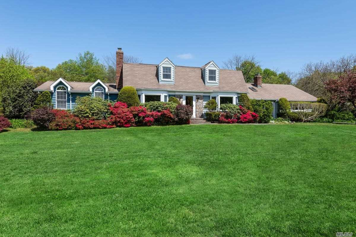 Mint Center Hall Dutch Colonial on two absolutely perfect acres. Updated Eat-in-kitchen; new baths; gracious rooms with great flow. Professional office suite with vaulted ceilings, half bath and separate entrance makes this an ideal set-up for professional working from home. Specimen plantings and mature landscaping with something in bloom for every season. Robbins Lane elementary.