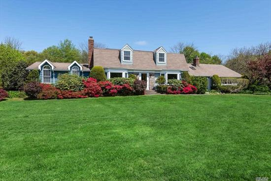 This Move-in Center Hall Dutch Colonial on two beautifully landscaped acres offers a choice of Syosset or Oyster Bay schools! Updated Eat-in-kitchen and baths; gracious rooms with great flow, large finished basement. Spacious in-law suite or Professional office with bath, separate driveway, parking and entrance makes this an ideal set-up for professional working from home or multi-generational living. Specimen plantings and mature landscaping - a gardener's delight! 4 min to LIRR station.