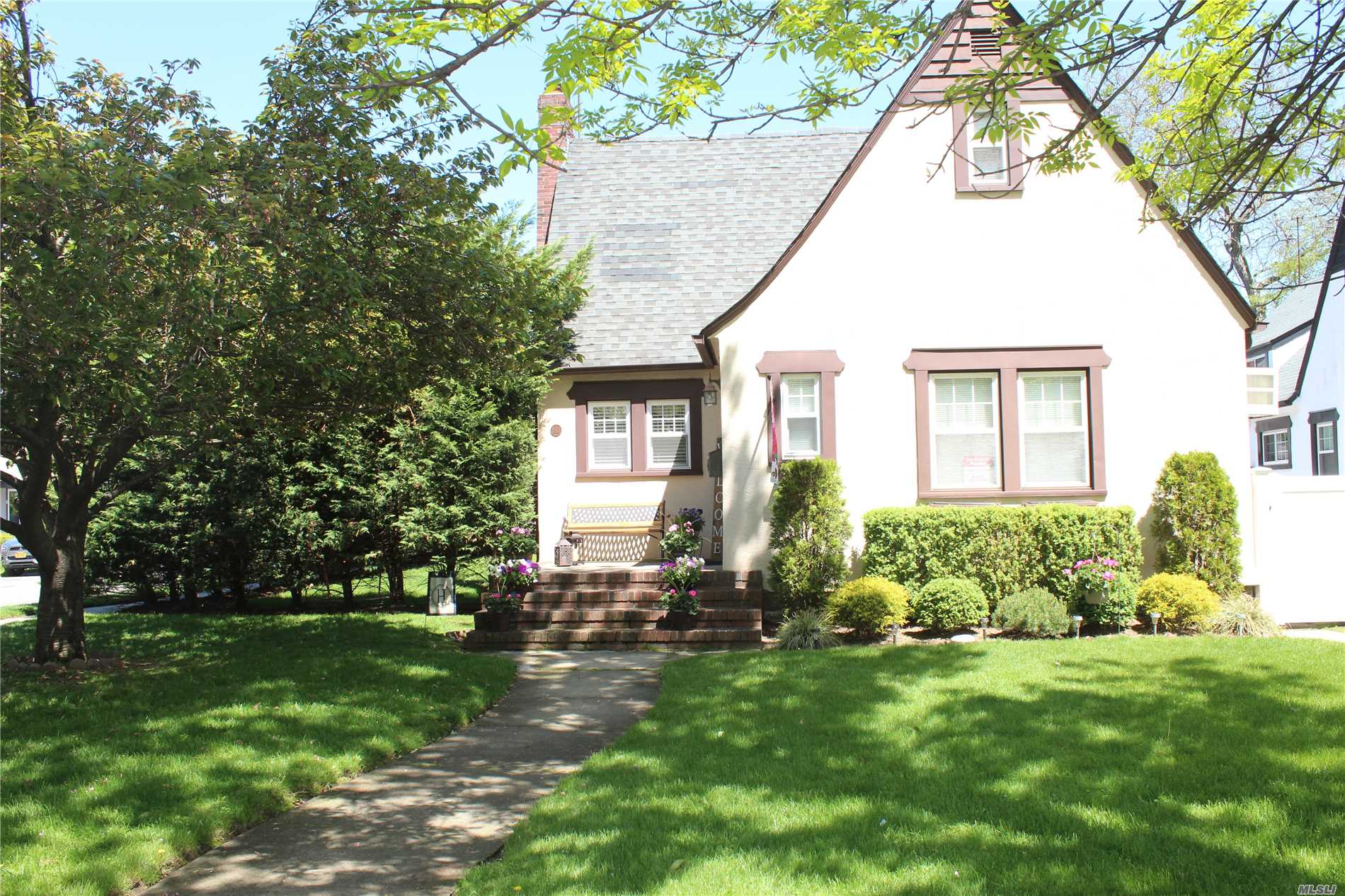Charming 3 Bedroom Cape offering Living room, Dining room , Eat In Kitchen with Stainless Steel Appliances,  2 Full Baths, 2 Car Garage, Corner Property,  Fireplace, 200 Amp Electrical Service, Wood Floors, Basement, In ground Sprinklers, PVC Fence, Washer/Dryer,  Over sized property, Spacious Back Yard, Great Curb Appeal, Short Distance to LIRR.