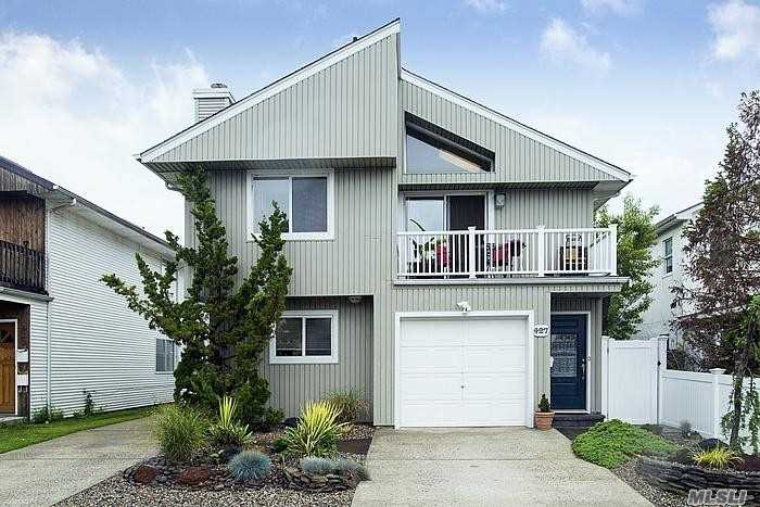 Mint Condition Upper Unit in Two Family Home Long Beach East End. 3 Bedroom 2 Bath With Updated Kitchen and Baths, Balcony, Living Room Dining Room With Vaulted Ceilings, Use Of Garage And Driveway.
