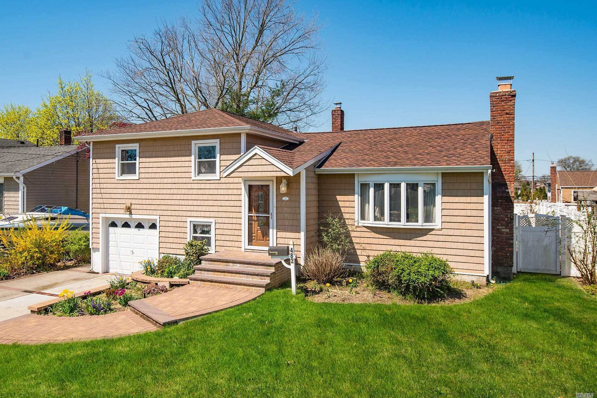 A Beautiful Split Level Home, Mid-Block Location on a Quiet Street in Massapequa Park. This Home Features a Spacious Lr w/ Wood Frplce & Vaulted Ceiling, Formal Dining Rm w/Slider to the Deck, Kitchen with New Granite Ctrs, Master Bdrm w/.5 Bath + 2 Bdrms and 2 Bthrms, Cozy Fam. Rm, Laundry/Pantry Area, Garage Entry and OSE, Finished Basement & Utilites, Gas/Ha, 2 Ductless Dual AC/Heat, A Fully Fenced Private Backyard, Enclosed Sunrm, Newer Exterior/Roof/Windows, 1 Car Garage, IGS, Low Taxes.
