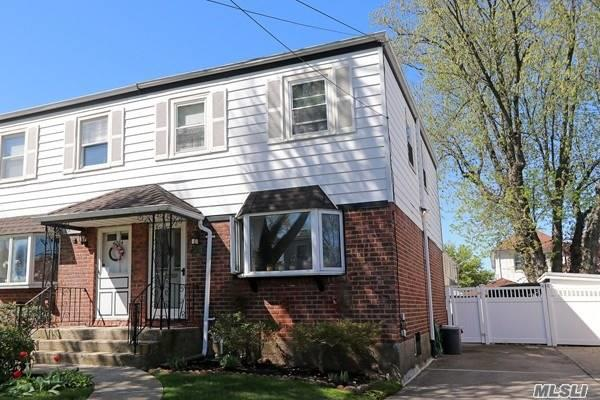 Beautiful Semi-Detached home Conveniently located in the heart of Bayside, 28X120 Lot in the middle of the Block, Features 3Bed 1Bath, Formal Dining Rm w/Open New Kitchen, Door to Large Back Yard with All fencing for privacy, Hard Wood Fl, Finished Basement, Close to Northern Blvd, LIRR, Bus, Schools, Restaurants, Shopping..A Must See-Wont Last