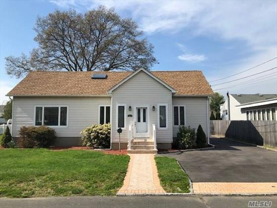 Beautiful Renovated & Spacious Colonial Boasts 5 Over Sized Bedrooms, 3 Full Baths, HW Floors Throughout. Over Sized Kitchen With SS Appliances, Double Oven & Granite Counters. Sliders Off Kitchen to Deck. Newer Vinyl Siding, Roof, & Windows. Huge House Great for Big Family or Room for Mom! Too Much to List...This Beauty Won't Last!