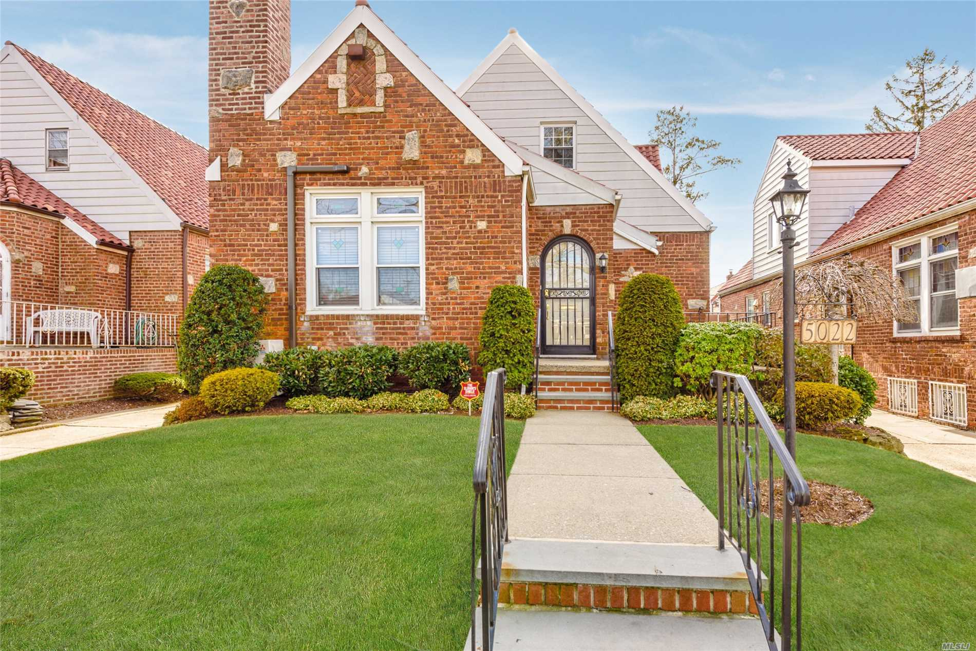 Rare brick tudor cape w/ charming details. Vaulted ceilings & wood beams in the living room w/ fireplace. Large formal diningroom. Kitchen is spacious with stainless steel appliances. Updated full BTH with two vanities. MBR is on the 1st flr. along with second BR. Up the stairs there are 3 BRs and one full BTH. Attic provides plenty of storage. The basement is expansive w/ OSE and Washer/Dryer. Pvt driveway with 1.5 garage & mature landscaping. District 26. Transportation close by.
