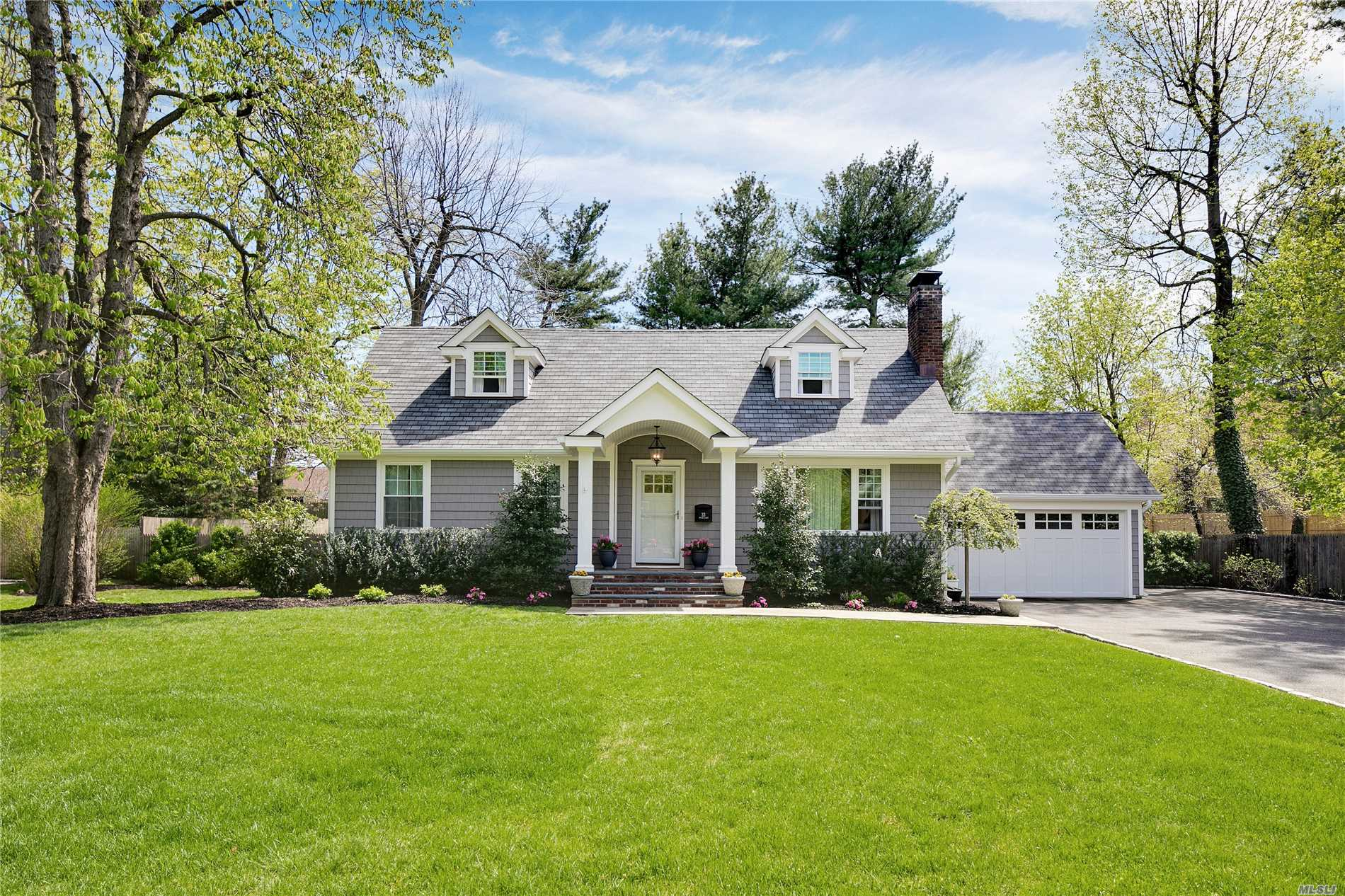 Picture perfect Lattingtown farm ranch in a mid-block location. Beautiful and newly renovated, turn key with new kitchen, living room with fireplace, and master bedroom on the first floor. Finished basement with gym, recreation room, full bath and laundry.