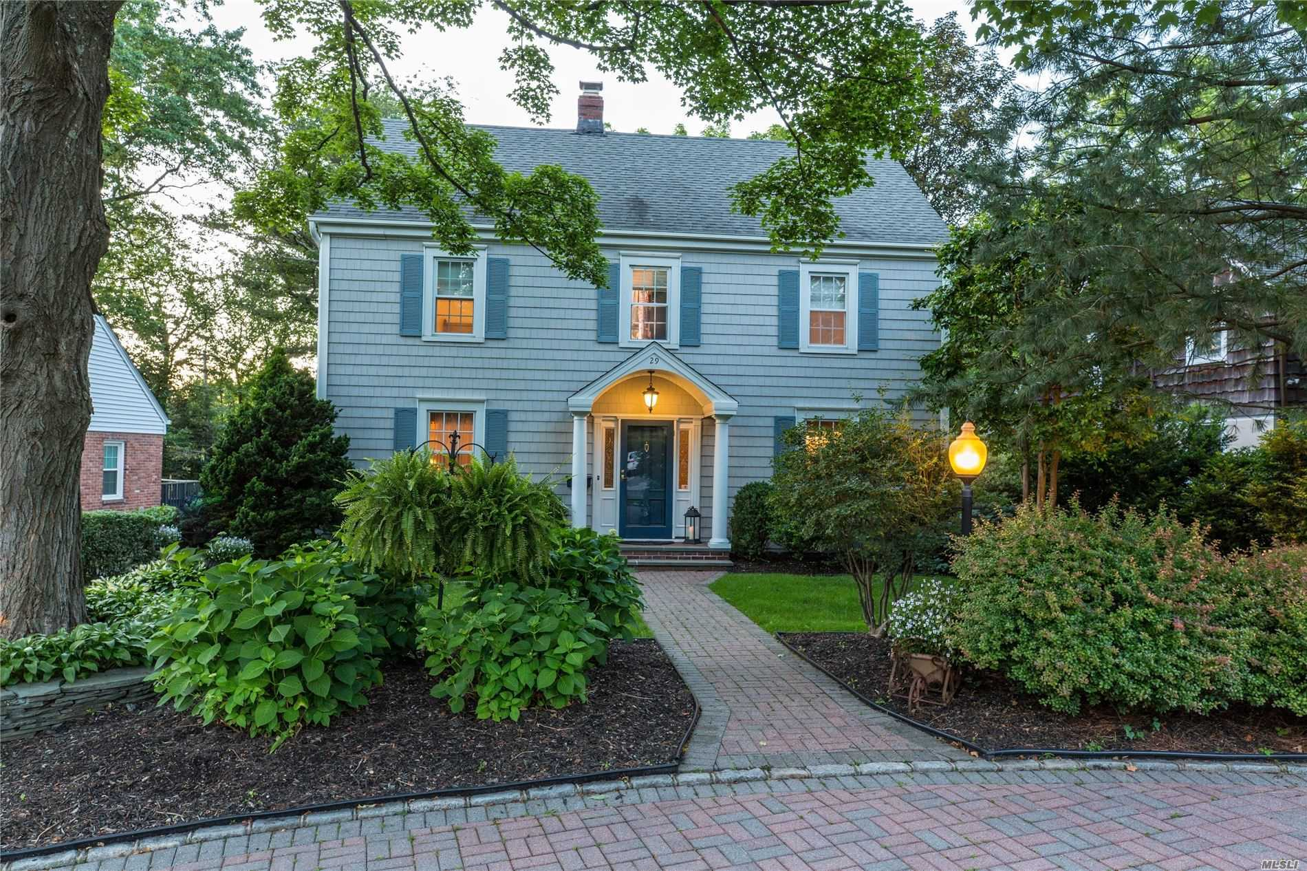 Beautiful BH colonial, updated and meticulously maintained. Offers 4 BRs/2.5 BTHs. Renovated, expanded kitchen w/high-end appliances, island, radiant heat leads to bi-level deck and large yard. LR w/FP, FR, formal DR, powder on first. Second offers master ensuite w/ expanded, reno bath and radiant heat. Three additional BRs, full bath renovated w radiant heat. Finished basement and finished walk-up attic. CAC, all systems replaced and updated, sprinklers, alarm. Just .7 miles from LIRR.
