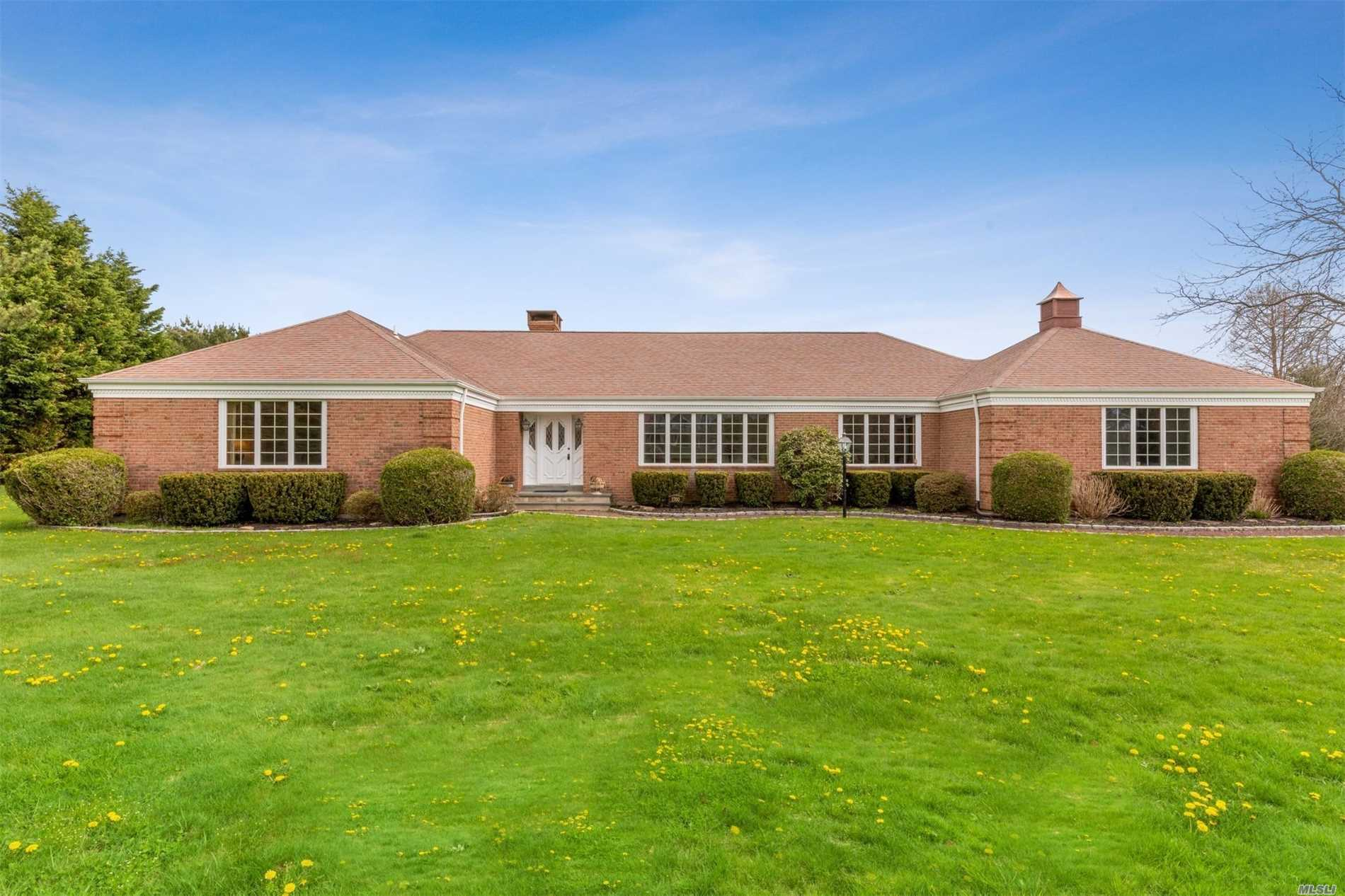 Stately Custom Brick Ranch Located On Manicured Acre, Features 3/4 Bedrooms, 2.5 Baths, Large Eat-In Kitchen, Living Room, Formal Dining, Great Room With Fireplace Overlooking Deck And Rear Yard, Laundry/Mud Room, 2 Car Garage.
