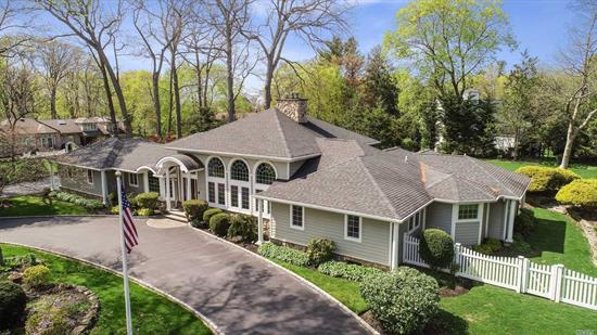 Once of a lifetime offering for this spectacular 4 bedroom custom expanded ranch!!! Walls of glass in your spacious Living room and Great room adorned with 16' ceilings and dual fireplaces make this a true one of a kind home. Enjoy first floor living with all the amenities of a grand home incl: Chefs kitchen w/ island, Breakfast room, Master suite w/ custom closets, His and Hers Master spa baths, generous guest rooms, tons of storage, 3 car garage, professionally landscaped property , stone patios