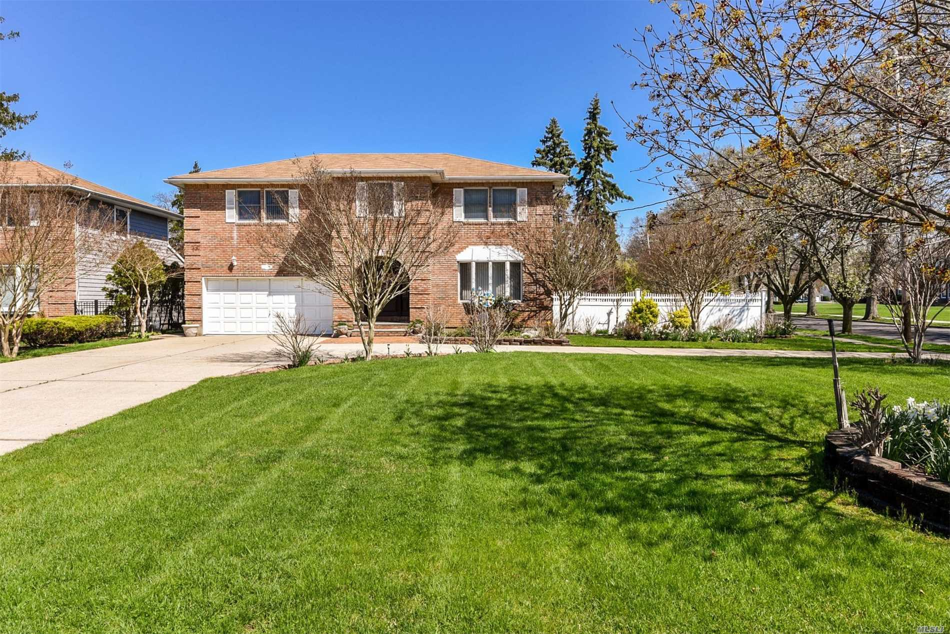 Clean & Meticulous Brick Colonial Set On .33 Acres In Desirable Wantagh Woods.This Home Features Entry Foyer W/Tiled Flrs, 2 Zone Cac, Andersen Windows, Eik W/Custom Cabinetry, SS Appls, Granite Counter Tops & Skylight, Fdr, Liv Rm, Den W/Vaulted Ceiling, Wood Burning Fireplace & Skylight, Master Ensuite, 3 Bedrooms, 1.5Baths, Full Basement W/Ose, 2 Car Attached Garage, Huge Fully Fenced Private Yard Perfect For Entertaining, Close To Schools, Shopping, Restaurant & Transportation.