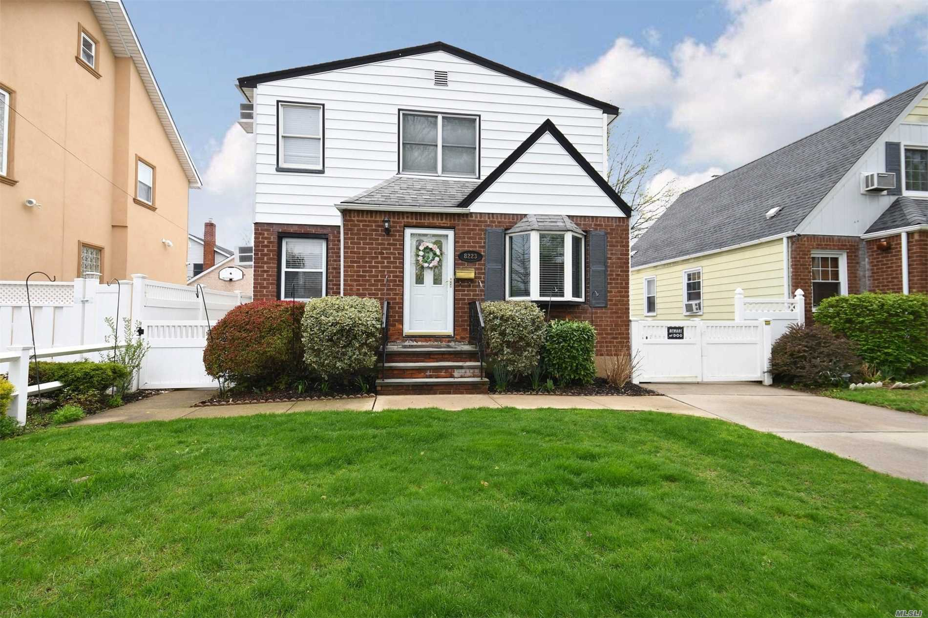Expanded fully dormered cape with 4/5 bedrooms(2 masters)and 2.5 baths, finished basement and 2 car garage. Wood floors on first floor only. Mid-block location, close to shopping, Hillside Ave and Union Tnpk buses, School District 26. Possible mother/daughter with proper permits.