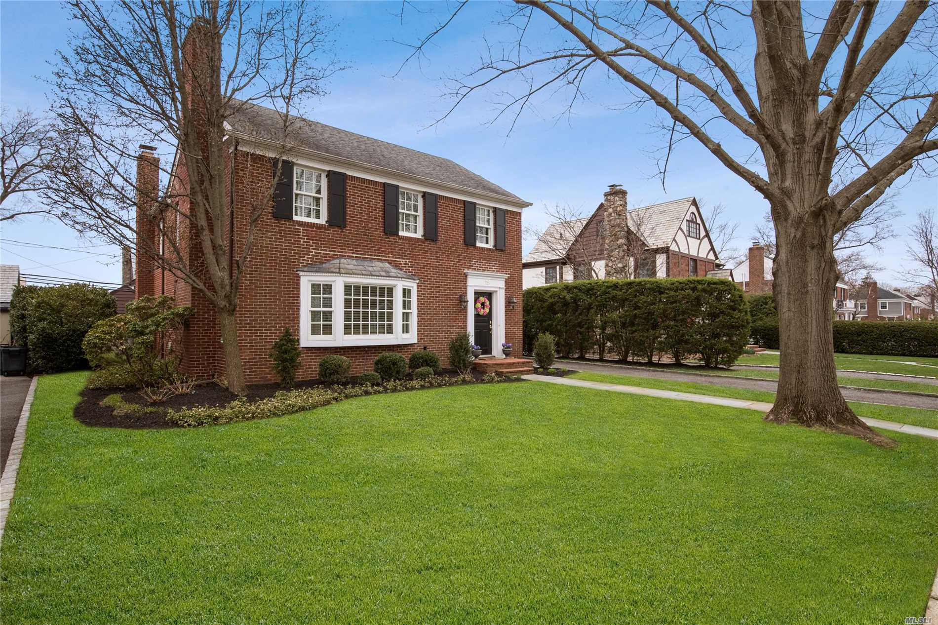Welcome to this inviting 4 bedroom, 2.5 bath brick colonial w/attached garage in the heart of the Estates. Situated on 60 x 110 prop. Master suite complete with large bdrm, luxurious bathroom and his/her walk in closets.  This property offers a stunning kitchen/ great room w/ FP, formal dining room, Formal LR with wood burning FP as well as spectacular outdoor living space complete with abundance of privacy. Add'l features: CAC, Alarm, Bose ent system, IGS, near to LIRR, Parks and schools