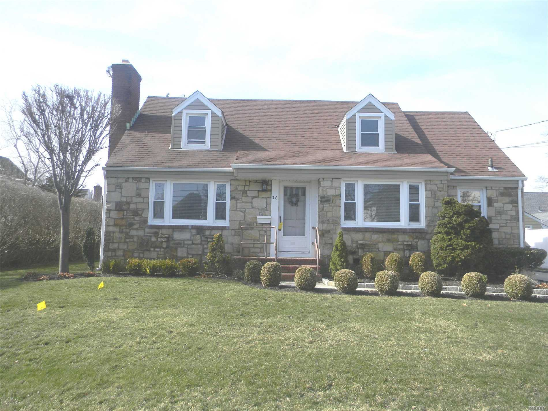 Spacious And All Updated Expanded Cape Including 4 Bedrooms, 2 Full Baths, Fireplace, Dining Room, Living Room, Sunroom,  Hardwood Floors, Gas Heat System. Washer & Dryer, Beautiful Yard. Unfinished Full Basement.