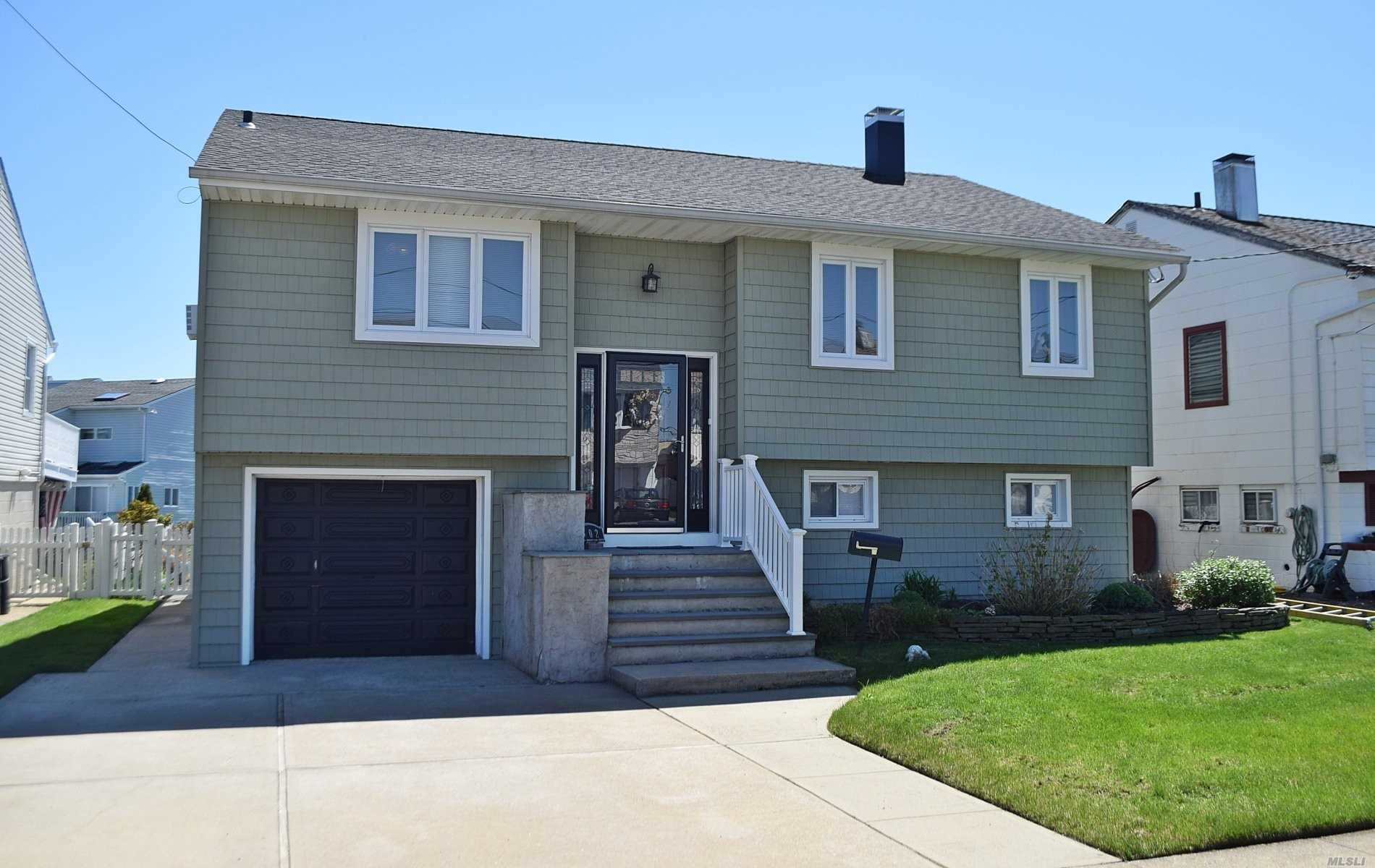 Spacious Waterfront Hi-Ranch with great views of the open Bay, wide deep water, can take large Boat. 4 B/R, 2 baths many updates, Gas burner, Hot water heater, Roof, Windows, new doors to deck, New Ramp, Floating Dock, large storage Shed with electric. Sprinklers,  low Taxes, Great location, in Cow Meadow Park.