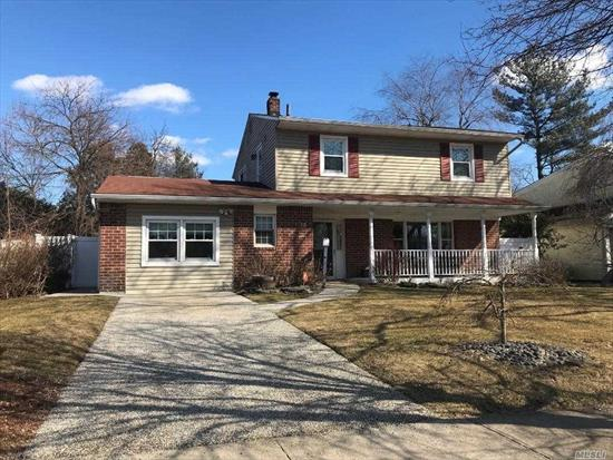 Spectacular Colonial For Sale In Hicksville. Move In Condition, 2054 Int Sq. Ft. Beautiful Open Front Porch, Large Family Rm, Possible 4th Bdrm, 1.5 Baths On 1Sr Flr, Updated Kitchen W/Large Dining Area. Corian Counter-Tops, Porcelain Tile Flrs, Wine Fridge, Double Oven, Large Deck On 2nd Flr W/Back Staircase, Covered Fieldstone Patio, Quiet, Private Back Yard, 1.5 Mi. To Hicksville Train Station.
