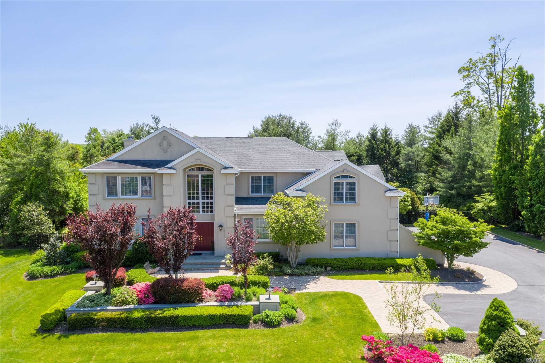 Low Taxes! Elegant CH Col in Rolling Hills 2 Est. 5 Spacious Bdrms and 3.5 Bths. Impressive 2 Story EF. Hrdwd Flrs. Entertain W/Easy Flow from Lrg Fam Rm- W/ Gas Fplce- to Sprawling EIK W/Beautiful Lt Cabinets & Gran Counter tops. Sep Lndry Rm/Mud Rm with Access To Yard, Plus 5th Bdrm & Bth Off Kit. Upper level W/ Mstr Suite W/ Tray Ceiling & Stunning Mrble Bth, 3 More Bdrms & FBth. Fab Bonus Rm. Full Bsmt. Landscaped 1/2 acre Prop W/ IG Htd Pool. Brick/ Bluestone Patio. 3 Car Gar. Syosset SD.
