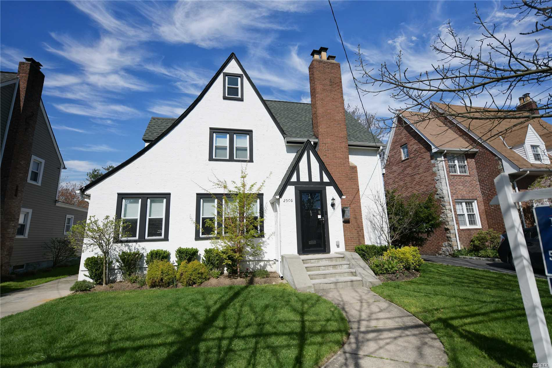 Beautiful water-view Tudor, park-like setting, granite counter-tops, updated electrical and all new wiring, new patio, new landscaping, new main water line, gas fireplace, sunlit breakfast room, walk to the park, This house has exactly what you are looking for!