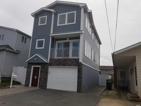 New Build!! Large Diamond condition Open Concept 3 story home. Spacious rear baydoor area for Indoor/Outdoor entertaining. Bright, sprawling LR/DR/EIK with Italian appliance. Large windows for natural light lovers! Parking for 3 cars. Near Train and all. All FEMA Compliant, Raised, Low Flood!!
