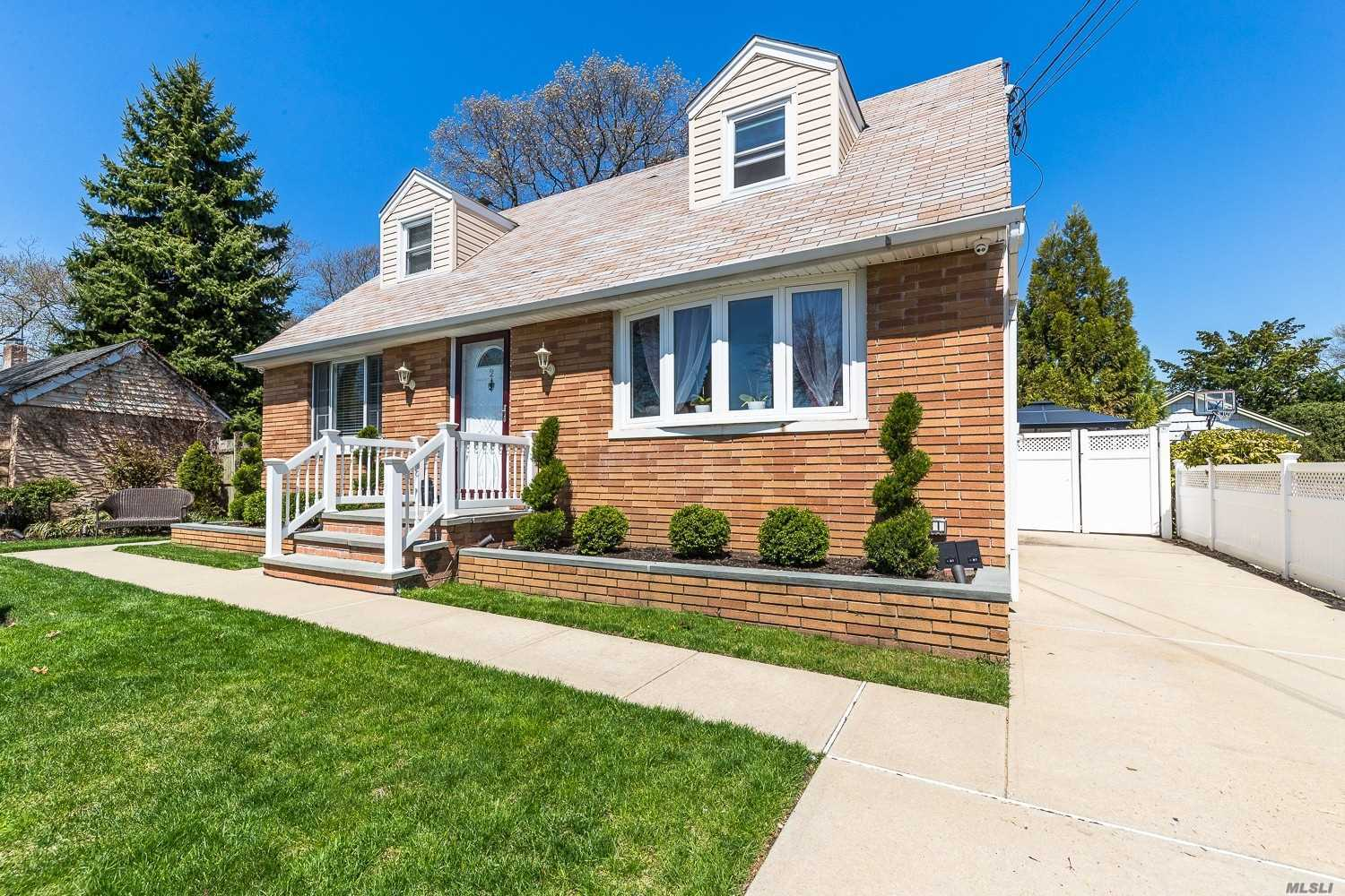 Move in ready 4 bedroom cape with updated kitchen and appliances. Beautiful hardwood floors. Manicured landscaping. 7 ft. deep, heated in-ground pool. A must see!