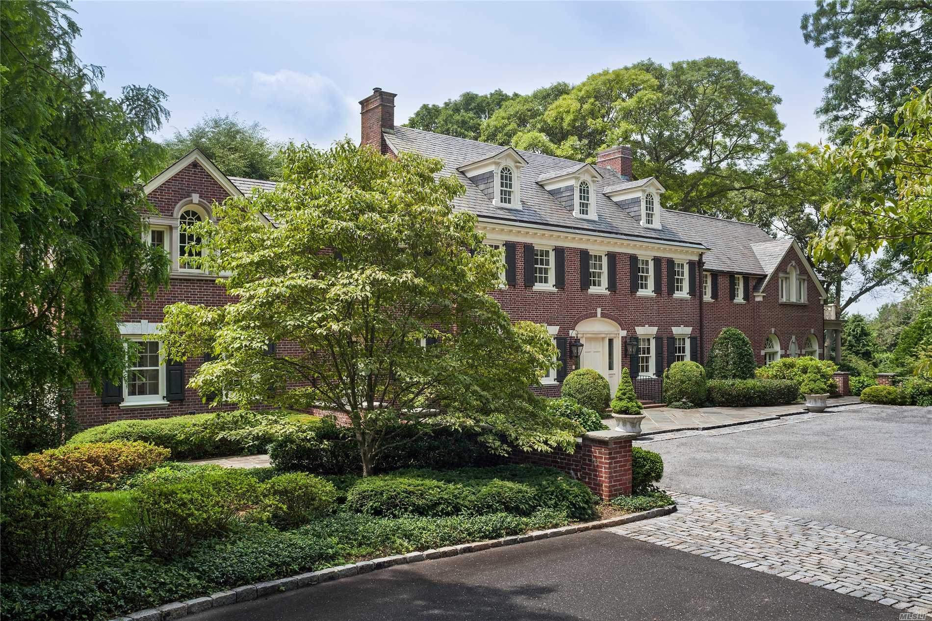Impeccable Brick Estate Compound Rebuilt By Modern Classicist Architect Oliver Cope. The Property Includes A 1932 Center Hall Colonial, A 3 Bedroom Palladian-Style Pool House Designed By Renown Architectural Firm George Post, And A Garage With Lodge-Style Office Suite. Set On 7.66 Acres Of Land With Specimen Plantings.