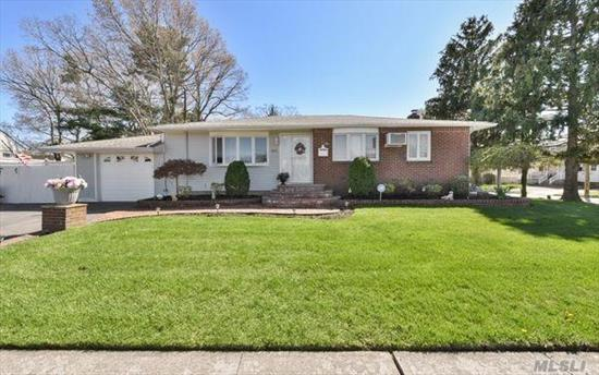 Clean & Meticulous Ranch Beautifully Landscaped Located In The Heart Of Massapequa Park. This Home Features An Open Floor Plan, Hardwood Floors Throughout, Eik, Living Room, Fdr W/Recessed Lighting, Full Bath, Full Finished Basement W/Ose, Fully Fenced Private Yard. In-ground Sprinklers, 7 Yr Old Roof, Andersen Windows, Soffit Lighting, 1.5 Car Garage, Low Taxes. Close To Schools, Shopping, Restaurants & Transportation. Move In Ready !