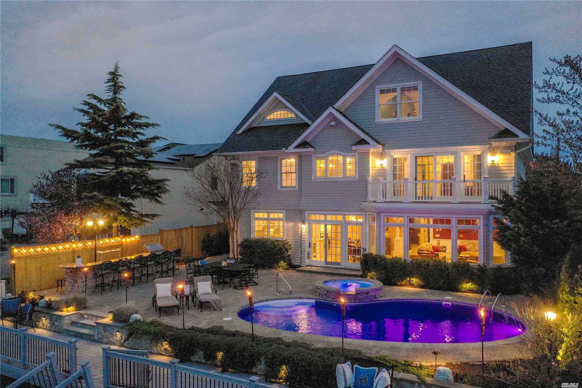 One Of A Kind Custom Built Waterfront Colonial On Resort Style Property. Open Floor-Plan, High-End Interior Trim & Designer Finishes Throughout, Chef Style Kitchen & Spacious Entertaining Areas. Brazilian Cherry Radiant Heated Floors, Surround Sound Speakers, Heated Saltwater Pool, Granite Bar, Large Floating Dock & An Endless Backyard!!