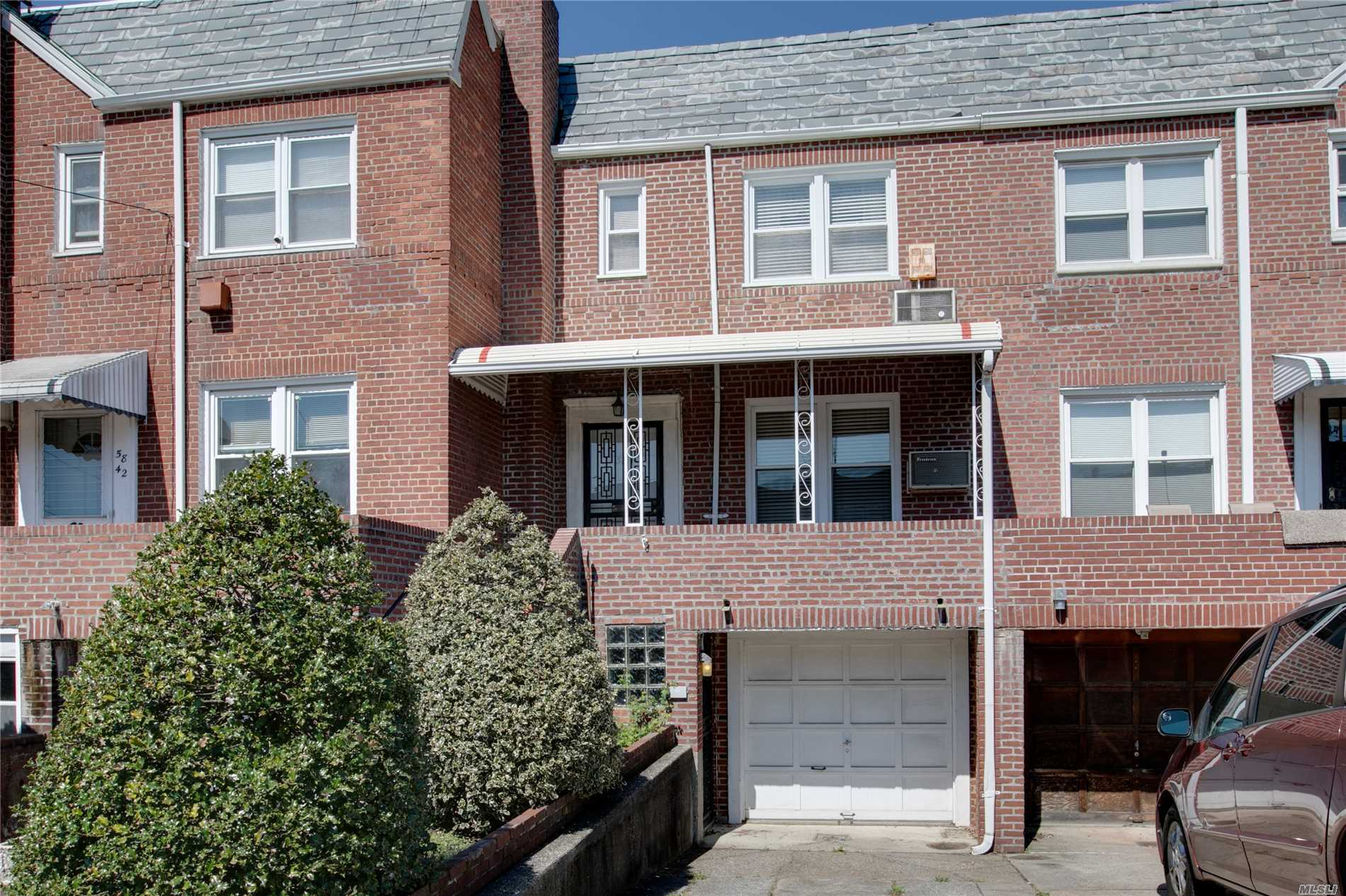 Attached Brick Townhouse Colonial in Queens-Borough Hill Section of Flushing. Lovingly Maintained by the Original Owners! The 1st Floor Offers a Foyer, LR, FDR, EIK. The 2nd Floor has 3 Bedrooms and a Full Bath. Finished Basement with OSE, Den, 1/2 Bath, Boiler and Laundry plus Attached Garage Oak Floors New Gas Boiler with Separate Water Tank. 4 Wall A/C Units, Front Patio with Eastern Exposure. Sweet Rear Yard. Short distance to Main Street and Transportation.