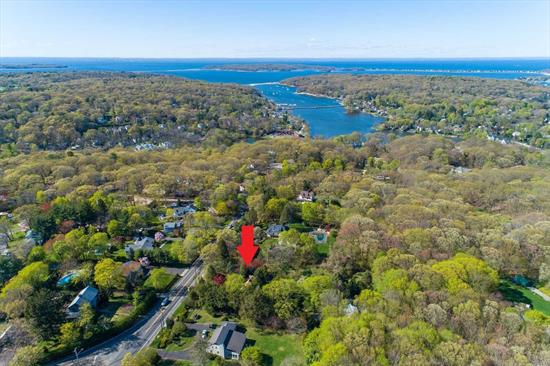 Being sold AS IS. Located in the desirable Harborfields School District, make this 3 bed/2.5 bath Cape your own. Situated on a flat 2.33 acres surrounded by mature trees and gardens providing ample privacy. Separate 2 car extended garage. Hardwood floors throughout, wood burning fireplace and heated sunroom. Located only minutes to Northport & Greenlawn Villages, beaches, train station and more. Needs TLC.