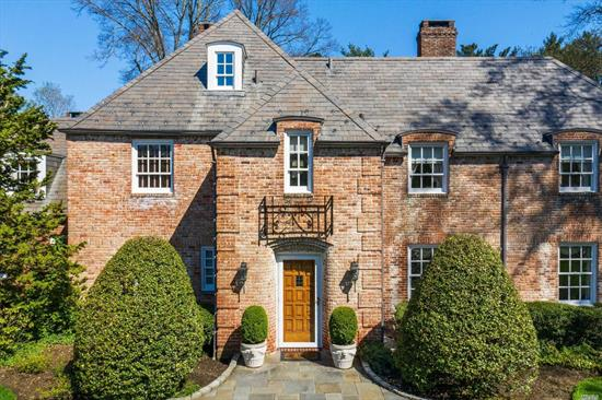 Eagles Nest-Stately beautiful brick French Normandy. Character and charm are evident in this 5, 000 sq.ft. estate complete with pond, pool house, 4 fireplaces, wine cellar and inground pool. Pristine and immaculately maintained home in the heart of Old Brookville awaits the discerning buyer who appreciates quality construction with charm and character situated on 1.75 majestic acres with super low taxes.
