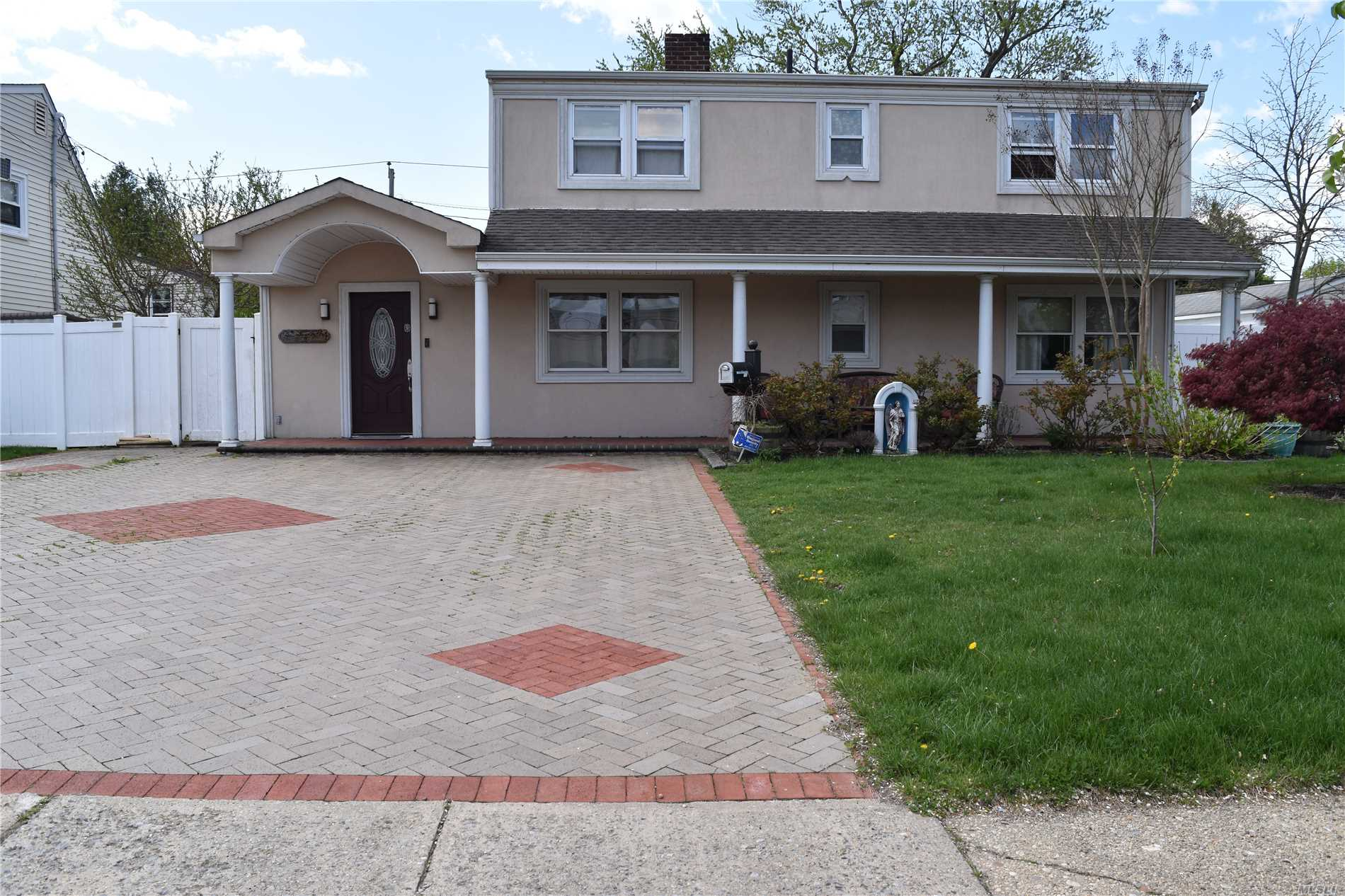 Don't miss it!!! Location, Location, Location! Beautiful house, 5 bedrooms, 2 full bathrooms, lovely kitchen, fireplace,  Eik, two walk-in closets, open floor layout, stainless steel appliances, new refrigerator. Spacious backyard perfect for entertainment. Close to everything, major parkway and shopping center. Plenty room for extended family. Possible accessory apartment with proper permit.