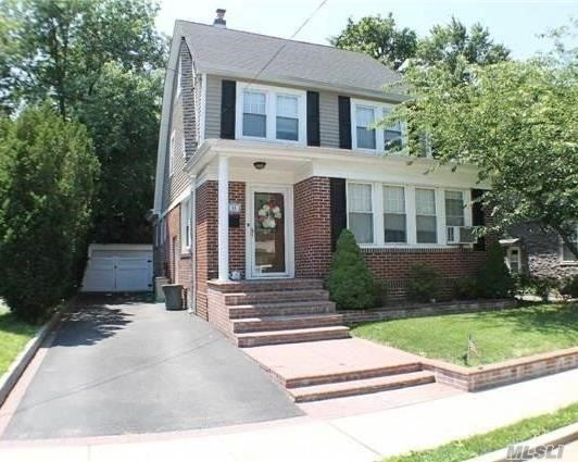 This charming colonial features an eat in kitchen, formal dining room, and a cozy living room area. Upstairs you'll find three bedrooms and in the attic is a full finished attic. Full basement and 2 car detached garage. Located in a close proximity to the heart of Malverne and minutes to the LIRR.