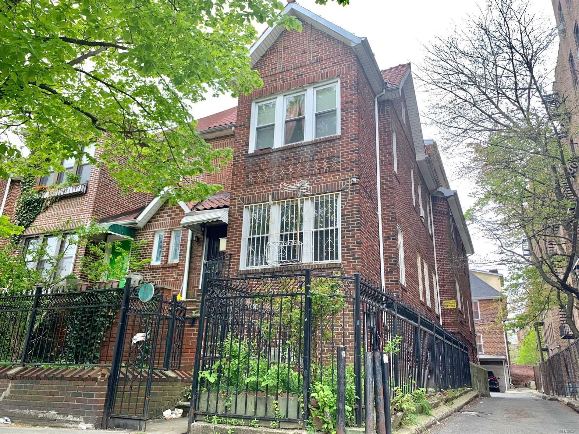 Legal Two Family, Semi-detached, Two Blocks From the 7 Train, 4 bdrms, LR/DR, 2 Full Baths on First floor and second floor, 1 Bedroom and 1 Full bath on the third floor, Walk in basement has attached two garages, 3 large Rooms, Full bath,  Two Additional Parking Space At the Rear of The House , Lot 32x100 and Building 22x65.75. Close to School s, stores and public transportations.