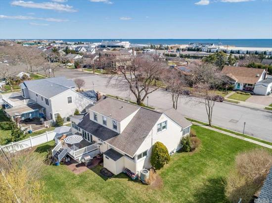 Sun-drenched updated cape on quiet cul-de-sac with master bedroom and bath on the 1st floor. CAC on 1st floor, Taxes being grieved. prime beach location, move in by summer.